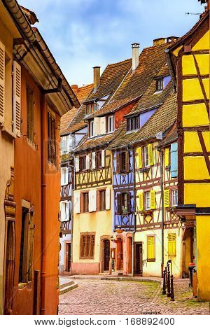 Colmar Petit Venice narrow street and traditional half timbered colorful houses. Alsace France.