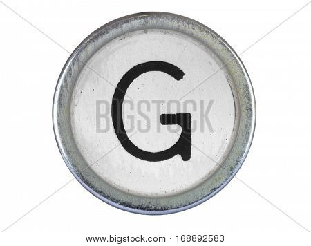 Vintage typewriter letter G isolated on white