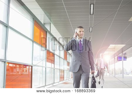 Full length of businesspeople rushing in railroad station