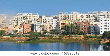 Bangalore, Karnataka, India - December 13, 2015: Colorful apartment homes in Bangalore city ,Residential home sales in Bangalore are at study growth of 9-10% over last 2 years.