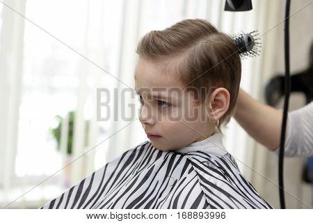 Kid In Hairdresser Salon