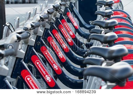 LONDON, UK - JANUARY 20, 2017. A row of bicycles known as Boris Bikes after the Lord mayor of London, Boris Johnson introduced a cycle hire business on the streets of London. Sponsored by Santander bank