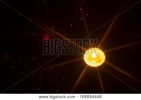 candle and candlelight with star filter effect