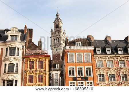 Lille France - 2015 December 27 : The facades of the buildings on the Grand-Place of Lille with the tower of the chamber of commerce in the background