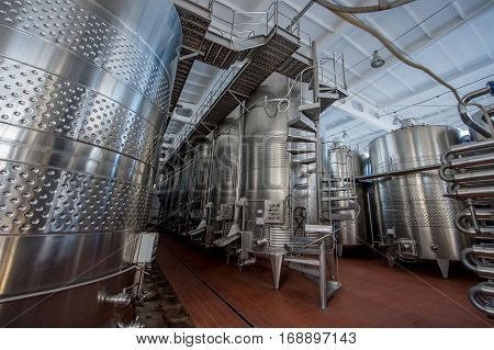 large metal containers for wine in the winery industry