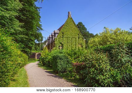 Abbey in Orval in belgium is famous for its trappist beer botanical garden and ruins of former seat of monastery - nowadays accessible to tourists