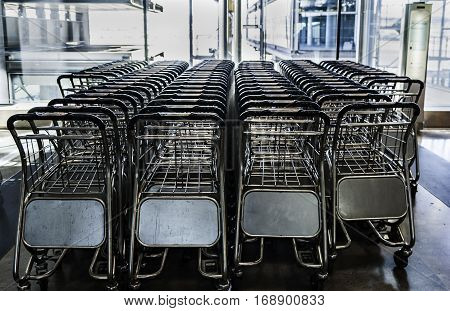Close up view of trolleys luggage in airport. Row of luggage carts in the airport