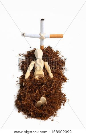 manikin buried in tobacco and with a cross made from cigarettes