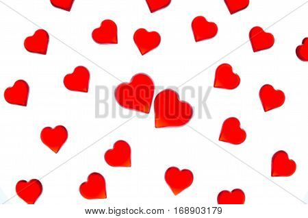 Bright red hearts on a striped background with two red hearts. In order to use Valentine's Day, weddings, International Women's Day