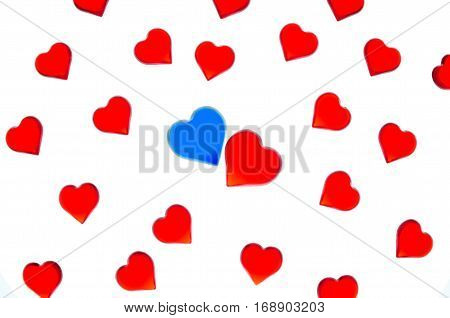 Bright red hearts on a striped background with blue and red hearts. In order to use Valentine's Day, weddings, International Women's Day