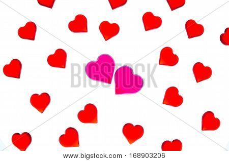 Bright red hearts on a striped background with two pink hearts. In order to use Valentine's Day, weddings, International Women's Day