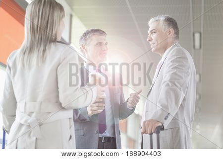 Businessman discussing with colleagues at railroad platform