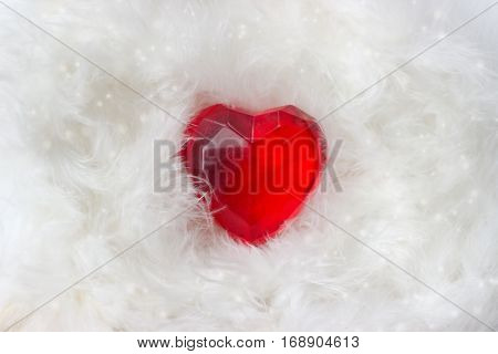 Red heart on white feathers background - valentines day card