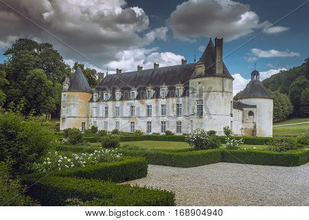 French Chateau of Bussy Rabutin with storm clouds in Burgundy France