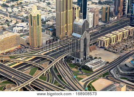 DUBAI UAE - JANUARY 28, 2017. Top view of a highway junction in Dubai UAE at sunrise. Sheikh Zayed road in Dubai downtown.