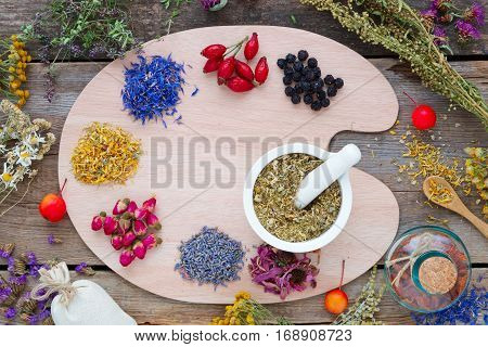 Healing Herbs On Wooden Palette, Mortar, Tincture Bottle And Medicinal Herbs On Old Wooden Board. To