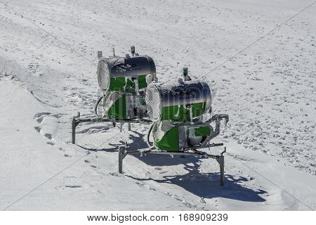 HINTERTUX, AUSTRIA - MARCH 28, 2015: Snow-making equipment (two snow guns) to increase the density of snow on the slopes of the Hintertuxer Glacier (Tuxer Ferner) in Tyrol Austria