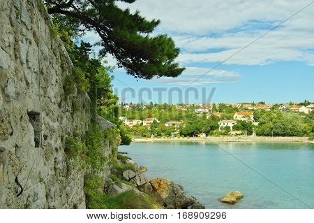 Krk Croatia: a town in the south of the island of Krk. It is a tourist resort in old town there are preserved fragments of buildings from Roman times. Defensive walls of the Frankopanski Castle.