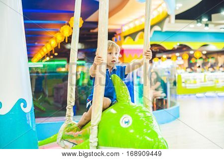 Young Boy Thrilled On The Carousel Ride