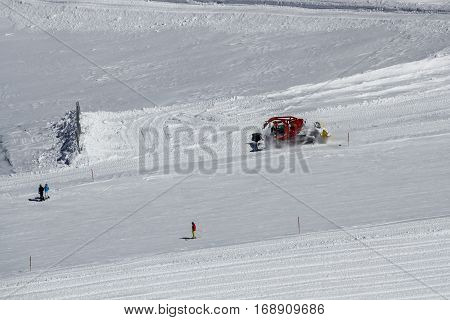 HINTERTUX, AUSTRIA - MARCH 28, 2015: Snowplow clears tracks to prepare the slopes of the ski region of the Hintertuxer Glacier (Tuxer Ferner) in Tyrol Austria