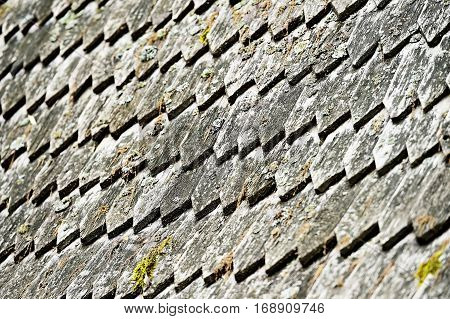 Architecture detail with old and weathered wooden roof tiles