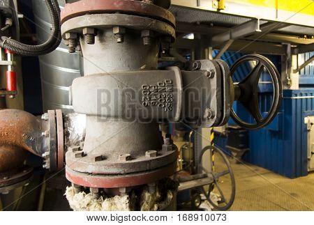 old big damper on the water pipeline