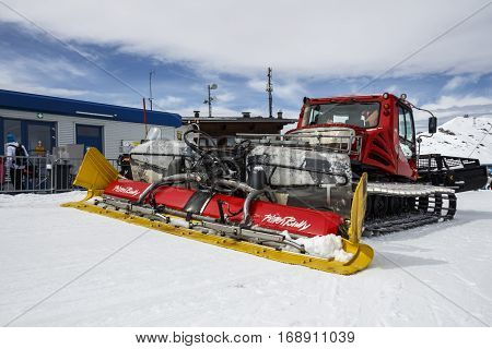 HINTERTUX, AUSTRIA - MARCH 29, 2015: Snowplow clears tracks at Penkenjoch in the ski region of the Hintertuxer Glacier (Tuxer Ferner) in Tyrol Austria