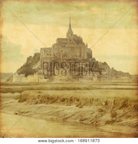 Grunge style photo of Mont Saint Michel. Normandy. France.