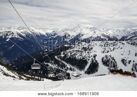 HINTERTUX, AUSTRIA - MARCH 29, 2015: Ski lift and a steep black piste at Horberg mountain in Tyrol Austria