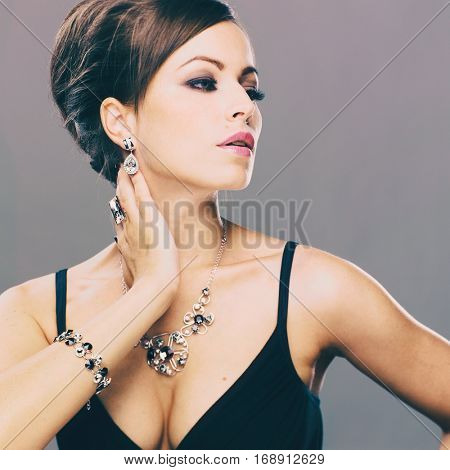 Beautiful woman with evening make-up. Jewelry and Beauty. Fashion photo. Beauty style woman with diamond accessories.