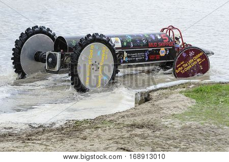 NAPLES FLORIDA/USA - MARCH 3 2012: Swamp buggy eases into water for next race