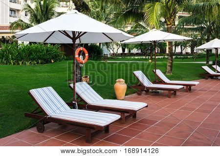 Sun beds on the hotel near pool.