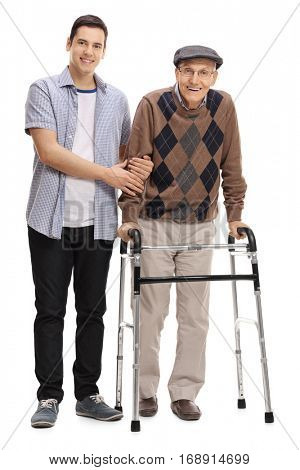 Full length portrait of a young man helping a mature man with a walker isolated on white background