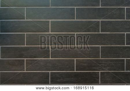 Long Gray Tiles with White Grout and a wood grain finish