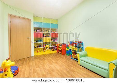 Kindergarten nursery game room light green interior.