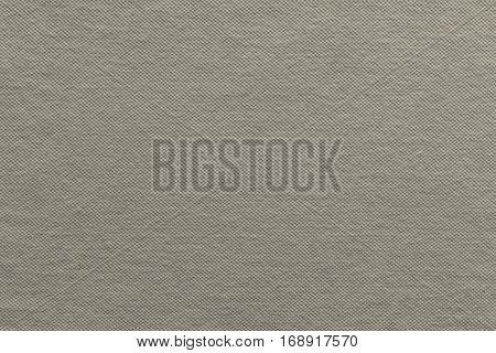 the textured background of cotton fabric or textile material of gray beige color