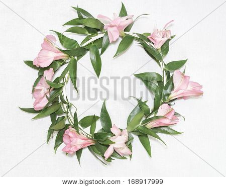 Bridal floral wreath with alstromerias on light background