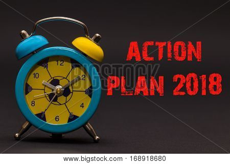 Action Plan 2018 Written With Alarm Clock On Black Paper Background