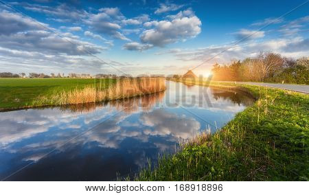 Buildings And Trees Near The Water Canal At Sunrise In Netherlands