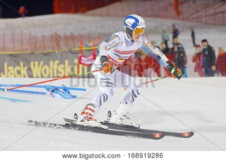 STOCKHOLM SWEDEN - JAN 31 2017: Side view of Linus Strasser (GER) in the parallel slalom downhill alpine skiing event Audi FIS Ski World Cup. January 31 2017 Stockholm Sweden