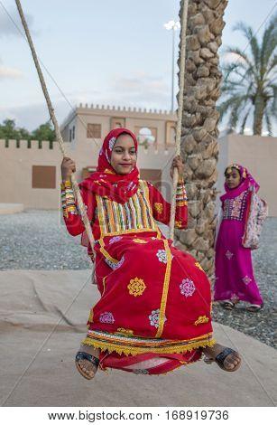 Muscat Oman February 4th 2017: omani girl on a swing