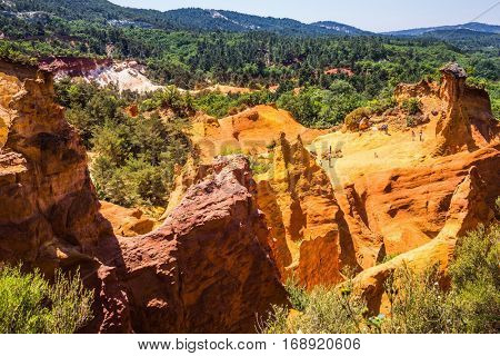Reserve - quarry for ocher mining. Orange and red picturesque hills. Languedoc - Roussillon, Provence, France