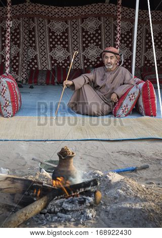Muscat Oman February 4th 2017: omani man with a walking stick resting