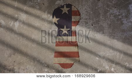 Usa Flag and Keyhole on Concrete With Gate Shadow
