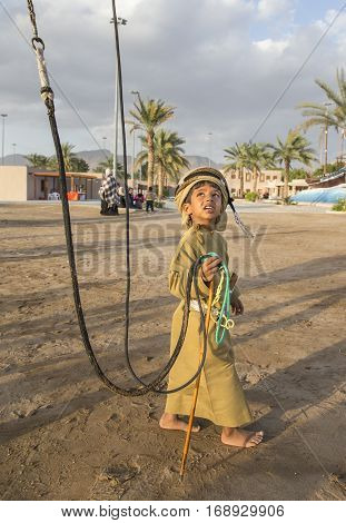 Muscat Oman February 4th 2017: young omani boy in traditional clothing