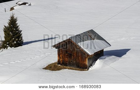 Small wooden hut in the Tuxer Alps on the Rastkogel mountain in Tyrol Austria