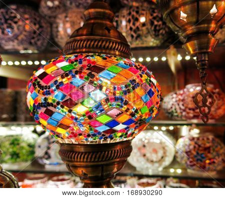 Colorful Turkish lamps in the Grand Bazaar of Istanbul Turkey. More than 32 million tourists visit Turkey each year.