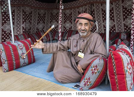 Muscat Oman February 4th 2017: omani man in traditional clothing resting