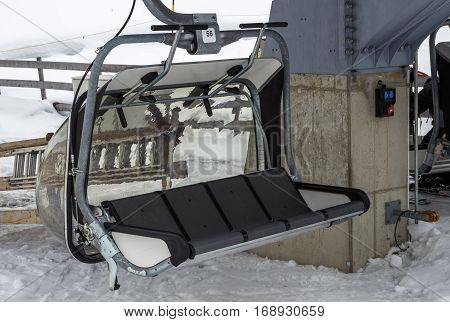 The ski lift Sun Jet at the Horberg mountain in Tyrol Austria with people in the queue for a lift to the mountaintop