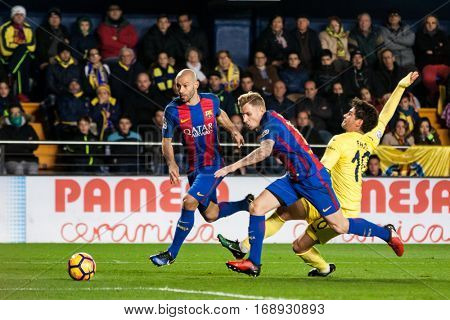 VILLARREAL, SPAIN - JANUARY 8: (R) Pato, (L) Mascherano, (C) Digne during La Liga soccer match between Villarreal CF and FC Barcelona at Estadio de la Ceramica on January 8, 2016 in Villarreal, Spain